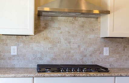 Granite counter and tile on wall installed on remodeled kitchen in Cheyenne Wyoming.